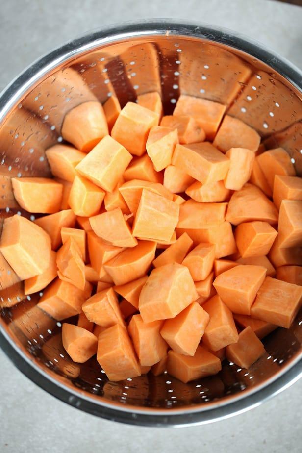 Sweet Potato Bake, Sweet Potatoes cut up in a colander