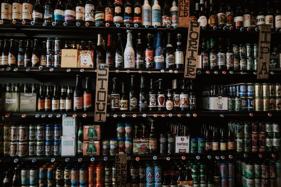 5 shelves of different types of beer and different brands