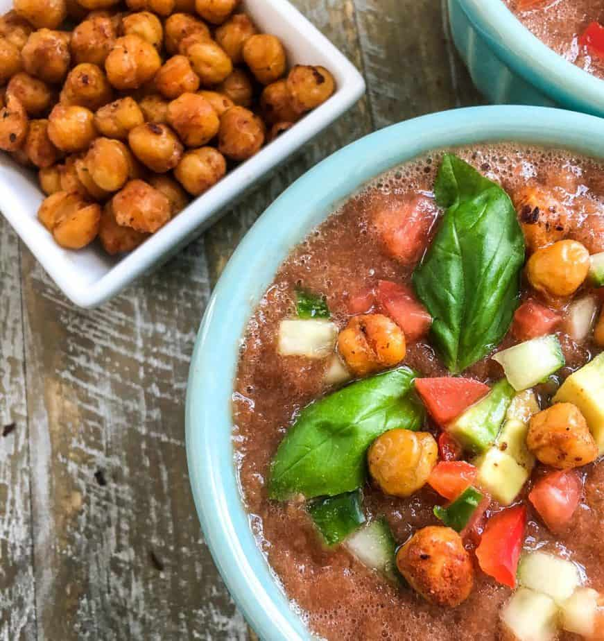 "Chilled Gazpacho with Crispy Chickpea ""Croutons"" in a bowl"