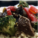 Close up shot of beef and broccoli over rice