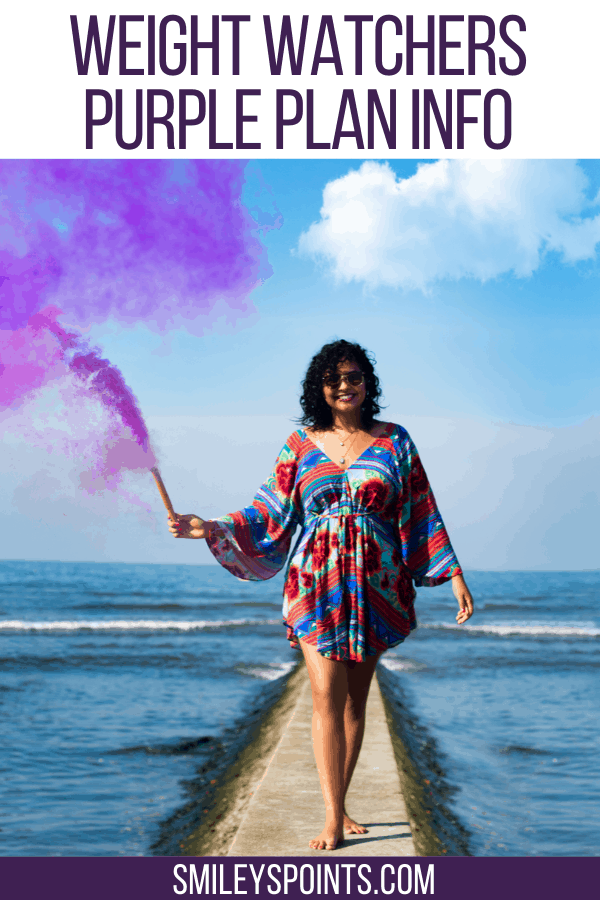woman holding purple smoke bomb