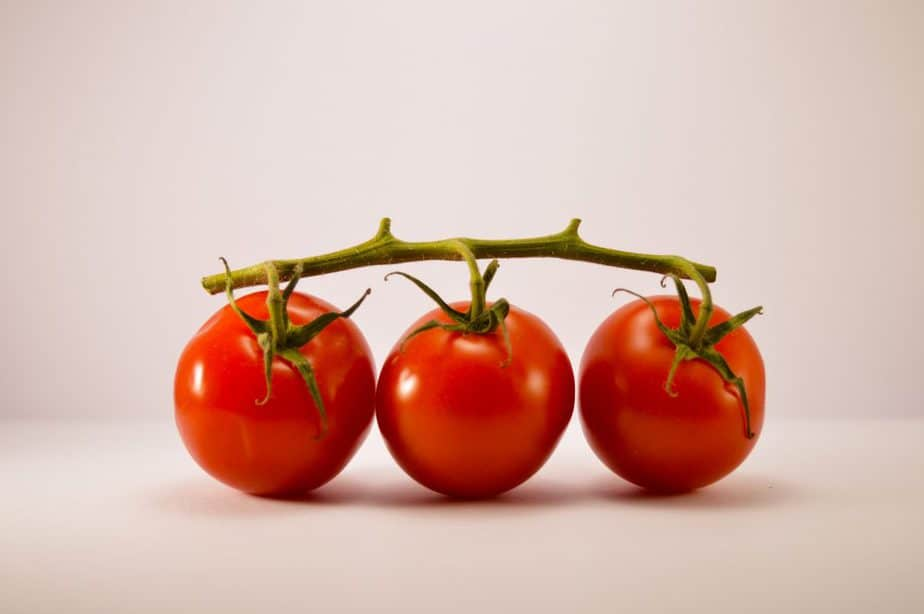 3 red cherry tomatoes on a vine