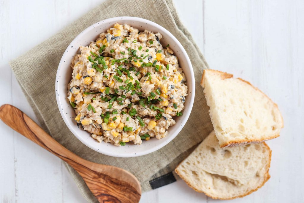 Chickpea tuna salad in bowl with slices of bread