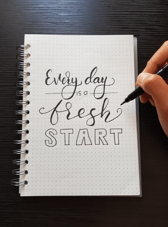 notebook that says: every day is a fresh start