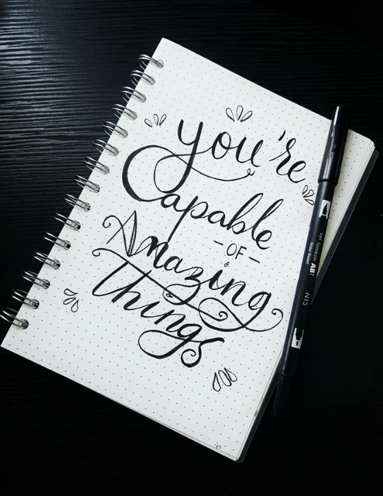 notebook that says: you're capable of amazing things
