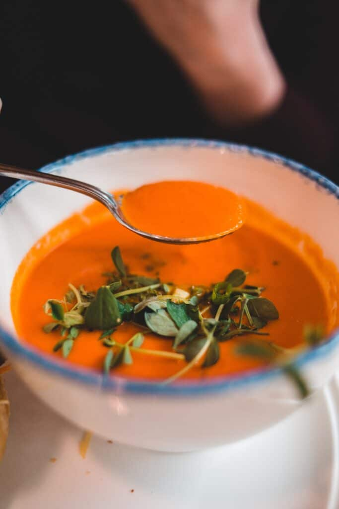 Bowl of tomato soup. Eawt soft foods for TMJ care.
