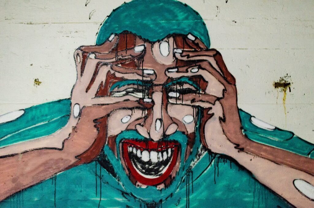 What is TMJ? Drawing of a guy in pain with his hands on his head.
