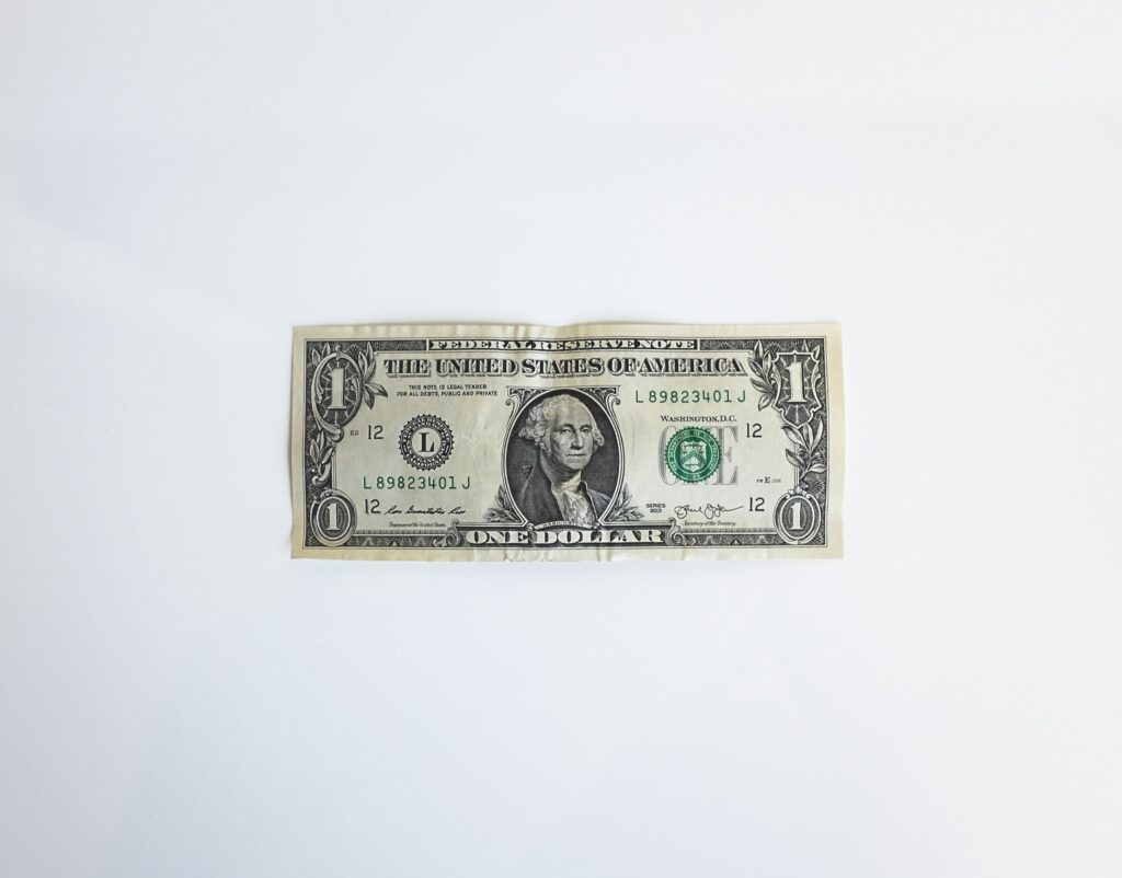 noom vs myfitnesspal cost. picture of a United States one dollar bill.