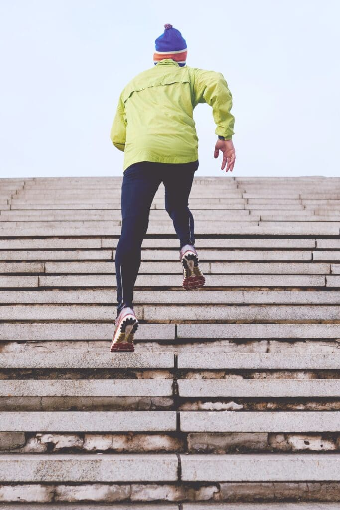 person running up the stairs. Being physically active